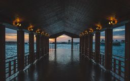 Wooden Hallway Near Water at Dusk Royalty Free Stock Images