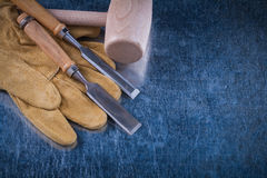 Wooden hammer firmer chisels and leather safety Royalty Free Stock Images