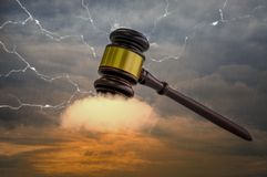 Wooden hammer, with golden metal center, placed on clouds. , The power of auction in world of modern business stock images