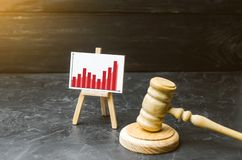 Wooden hammer of a judge and a stand information graphics. Rising crime. Improving efficiency of the judicial system, countering. Corruption. growth of stock image