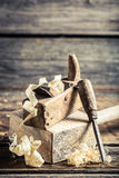 Wooden hammer and planer in a carpentry workshop Stock Photo