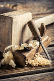 Wooden hammer, planer and chisel on a carpentry workbench Stock Photo