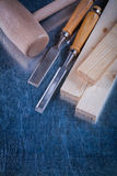 Wooden hammer studs and firmer chisels on Royalty Free Stock Images