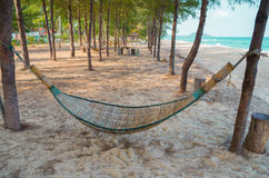 Wooden hammock with sand on beach. Royalty Free Stock Photo