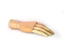 Wooden hand. A wooden model of a human hand on a white background. Shot taken from 2/3 perspective. Photo taken of the backside of the hand. Mostly used as a Royalty Free Stock Image