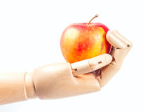 Wooden hand with apple Royalty Free Stock Photography