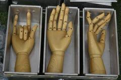 Wooden hand artist show flexible thumb stock photo