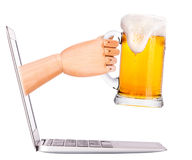 Wooden hand with beer and  laptop Stock Photography