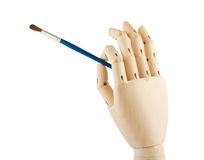 Wooden hand and brush Royalty Free Stock Images