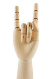 Wooden hand displaying devil horns Royalty Free Stock Image