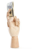 A wooden hand with dollars Stock Photos