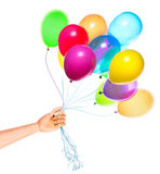 Wooden hand gives flying balloons Royalty Free Stock Photo