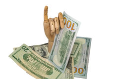 Wooden hand holding dollars close up detail macro. Wooden hand holding many dollars close up detail macro Royalty Free Stock Photography