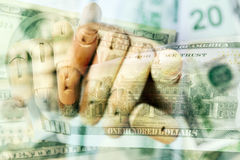 Wooden hand holding dollars close up detail macro. Wooden hand holding many dollars close up detail macro Royalty Free Stock Images