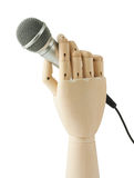 Wooden hand holding a microphone Stock Images