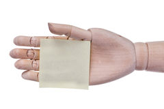 Wooden hand prosthesis holds sticker frame for an inscription. Royalty Free Stock Images