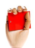 Wooden hand with red card Royalty Free Stock Photography