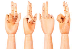 Wooden hand is showing two fingers Stock Photography