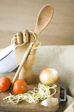 Wooden hand with spoon Royalty Free Stock Photo
