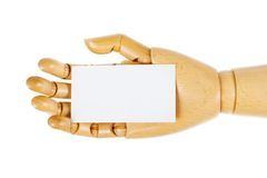 Wooden hand with white card Stock Photo