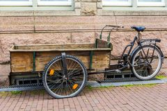 Wooden handcart built on bicycle frame for transporting goods through Amsterdam Royalty Free Stock Images