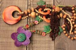 Wooden handcraft. Jewellery texture necklaces Stock Images