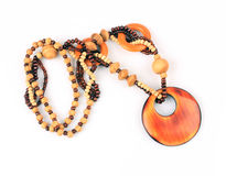 Wooden handcraft  necklaces. Wooden handcraft jewellery texture necklaces Royalty Free Stock Photography