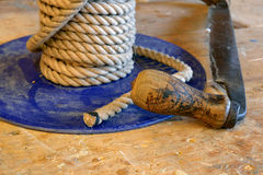 Wooden handle sanding and grinding tool next to a coil of fresh Royalty Free Stock Photography