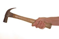 Wooden handled Hammer. Hand holding a wooden handled hammer Royalty Free Stock Photography