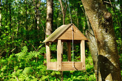 Wooden handmade bird feeder in form of small house Stock Photo