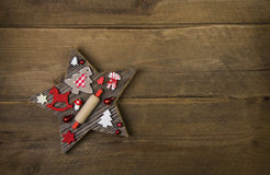 Wooden handmade carved star with red and white christmas decorat Stock Photo