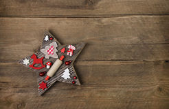 Wooden handmade carved star with red and white christmas decorat Stock Photos