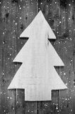 Wooden handmade christmas tree in shabby style on a wood snowy b Stock Photography