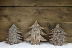 Wooden handmade christmas trees - natural congratulatory card. Royalty Free Stock Photos