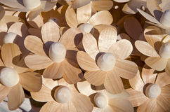 Wooden handmade craft flowers in market Stock Photo