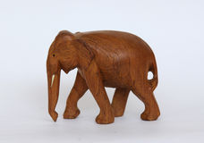 Wooden handmade elephant statue isolated on white stock images
