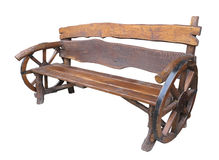 Wooden handmade garden bench with cart wheel decoration isolated Royalty Free Stock Image
