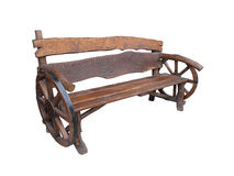 Wooden handmade garden bench with cart wheel decoration isolated Royalty Free Stock Photos