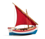 Wooden handmade toy boat with a red sail Royalty Free Stock Photography