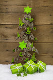 Wooden handmade tree with green presents for christmas. Royalty Free Stock Photos