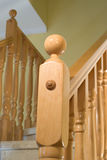 Wooden handrail. On a ladder inside of an apartment royalty free stock images