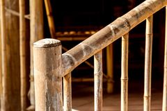 Wooden handrail of bamboo summer house. Wooden handrail of bamboo summer house lit by sunlight close up royalty free stock images