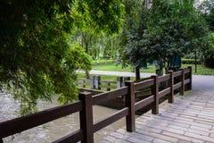 Wooden handrail of bridge in sunny summer Stock Photo
