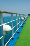 Wooden handrail on cruise ship deck at sea. Wooden handrailing on cruise ship deck at sea with blue sky and ocean views Royalty Free Stock Photos
