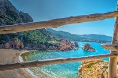 Wooden handrail in Li Cossi beach Royalty Free Stock Image