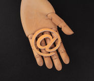 Wooden hands, holding email symbols Stock Images