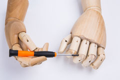 Wooden hands and screwdriver. On White background royalty free stock images