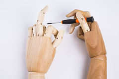 Wooden hands and screwdriver. On White background royalty free stock photo