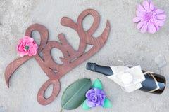 Wooden handwritten sign love on concrete background Stock Photo