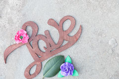 Wooden handwritten sign love on concrete Royalty Free Stock Images